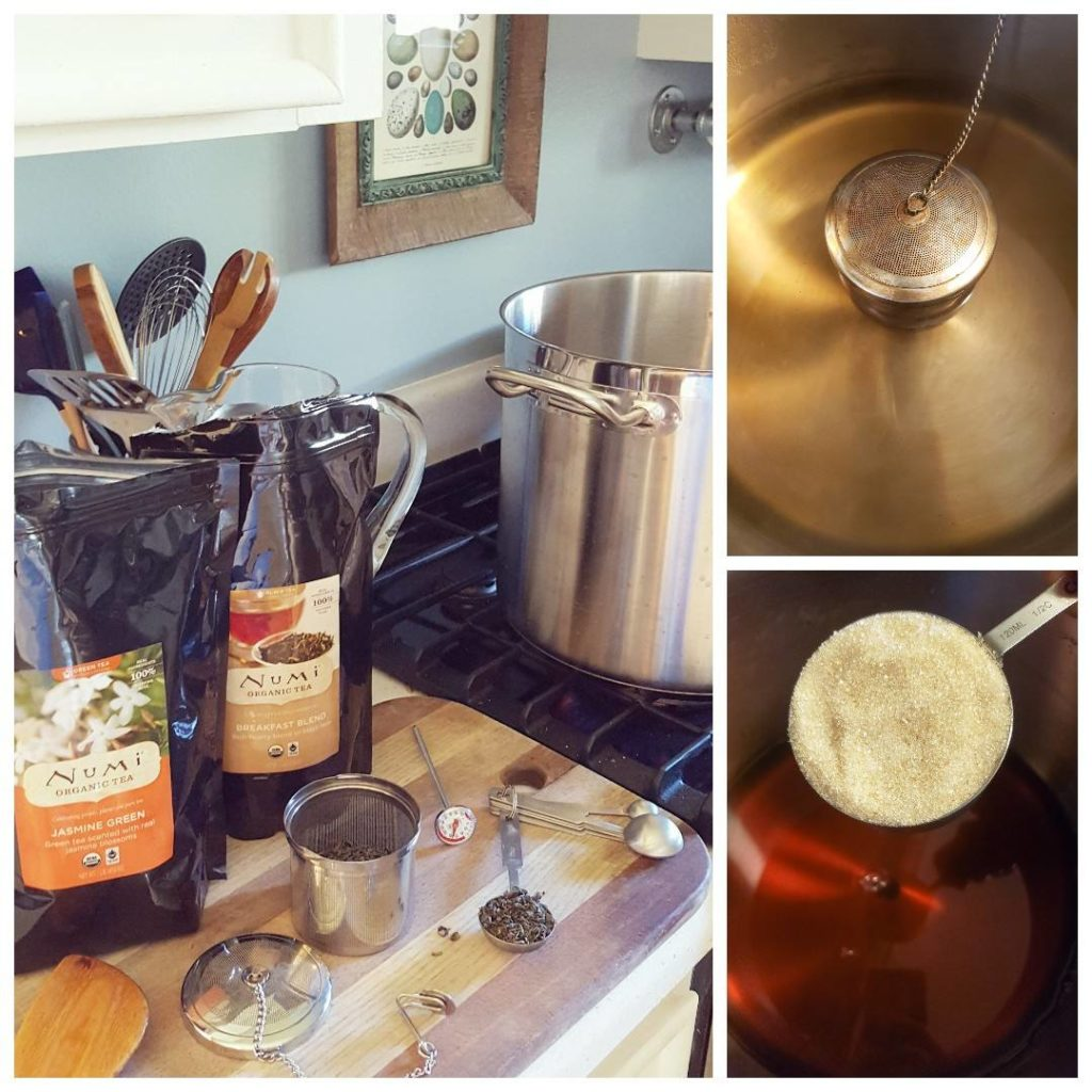 Brewing tea in a large stainless steel pot on a stovestop, using a stainless steel infuser and loose leaf tea.
